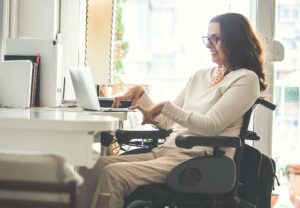 Disabled computer user enjoying Morphic's accessibility features to make using a computer easier.