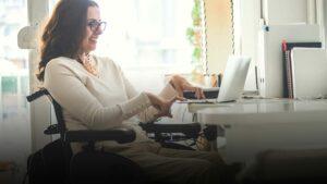 Woman in a wheelchair using a computer